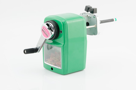 hand crank: green sharpener pencil on white background Stock Photo