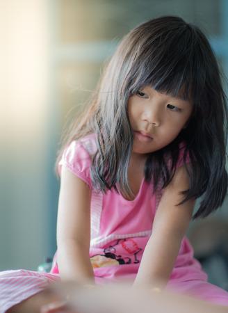spiritless: portrait of asian girl thinking something