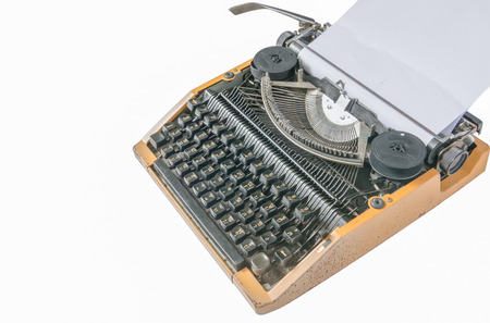 inserted: Old vintage typewriter with a blank sheet of paper inserted