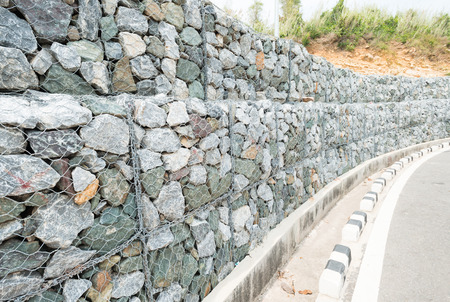 desiccation: Stone wall  for protect rock fall down and erosion from hill in Thailand