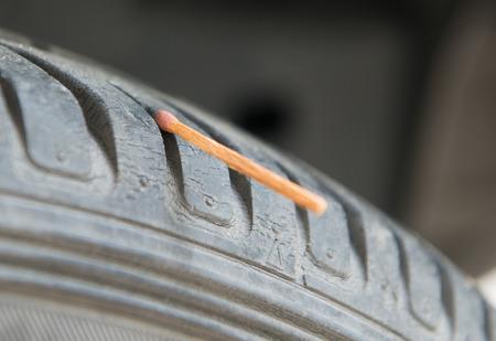 depth measurement: Measure tire profile with match Stock Photo