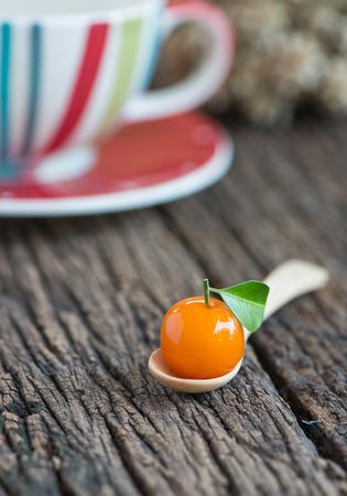 Deletable imitation fruits Thai dessert on wood background photo