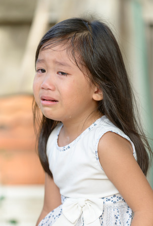 crying: Cute little asian girl crying at home. Stock Photo