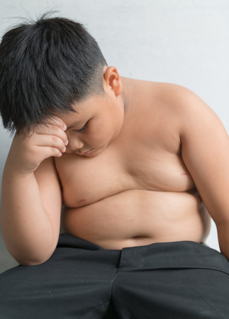 strained: Asian fat boy strained themselves overweight. Stock Photo
