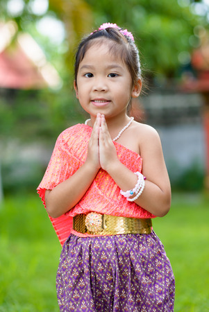 thai ethnicity: cute asian girl wearing typical thai dress on nature background