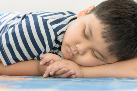 fat kid: fat boy sweet dream on his arm Stock Photo