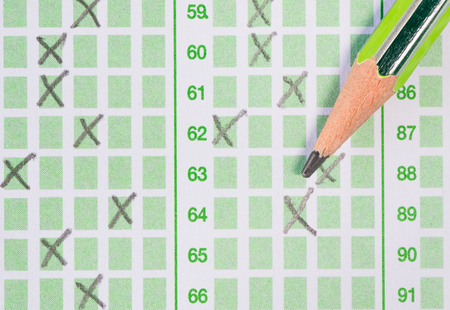answer: pencil on green answer sheet Stock Photo