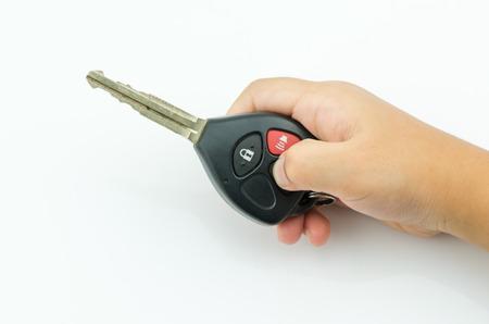 car lock: little hand press unlock on remote control key car isolatedl
