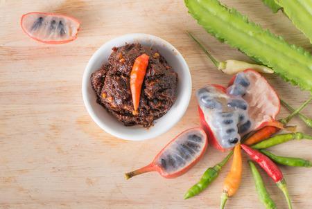 annonaceae: Nam Prig Pha, Thai spicy chilli dip on wood background Stock Photo