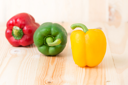 vegetable background: Fresh yellow sweet peper on wooden background Stock Photo