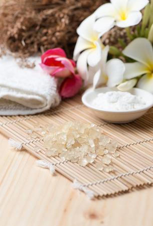 herbal background: Herbal salt scrub for spa on wood background Stock Photo
