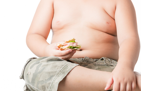 fat kid: sandwich in fat boy hand isolated on white background