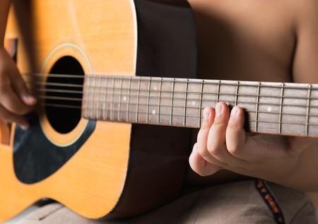 little finger: little finger boy on guitar