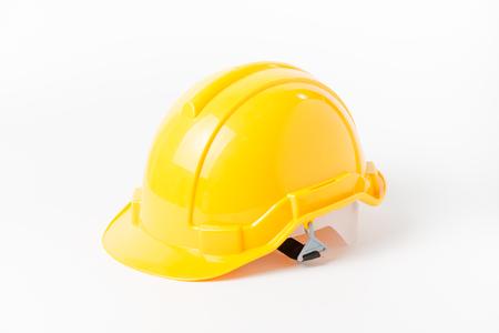 isolated on yellow: Yellow helmet engineer isolated on white background