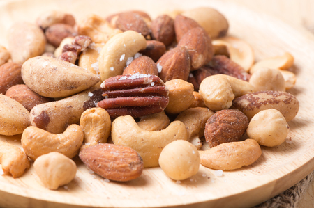mix of various nuts on wooden background