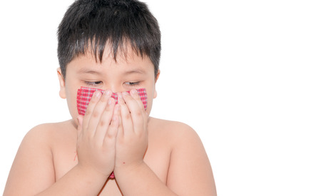 handkerchief: fat boy Use a handkerchief when coughing isolated on white Stock Photo
