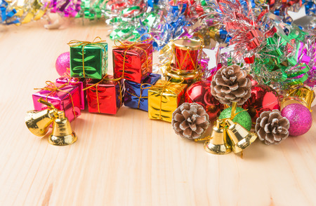 pine  fruit: pine fruit and gift chirstmas on wooden background Stock Photo