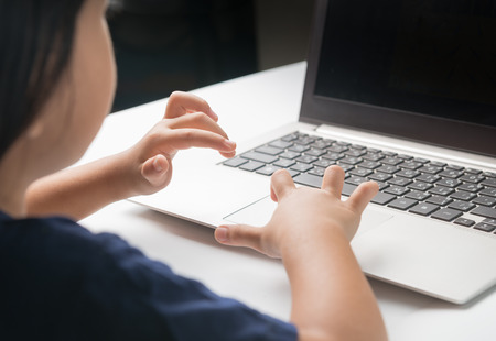 little: Little girl use computer do homework at home