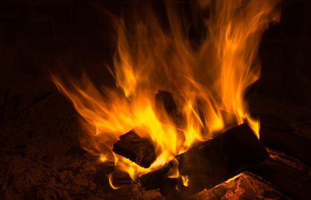glut: fire on firewood in a chimney Stock Photo