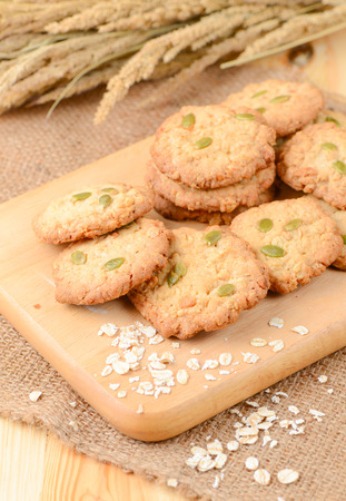oatmeal cookie: Cereal cookies on wood plate