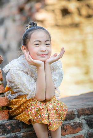 historic place: Cute asian girl on thai dress classic in historic place background
