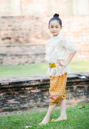 historic place: Cute little girl wearing typical thai dress in historic place