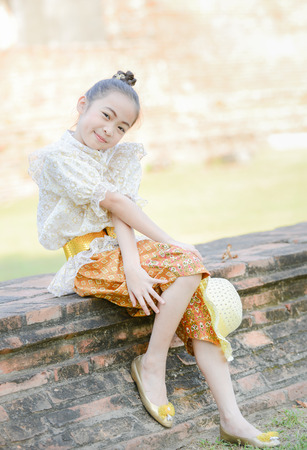 historic place: Cute little girl wearing typical thai dress on historic place