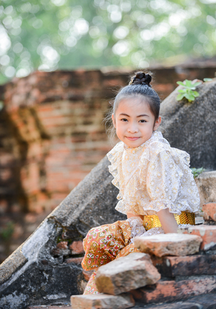 woman in dress: cute asian girl on Thai dress and historic background