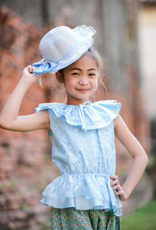 fashion girl style: cute asian girl on Thai dress on temple background