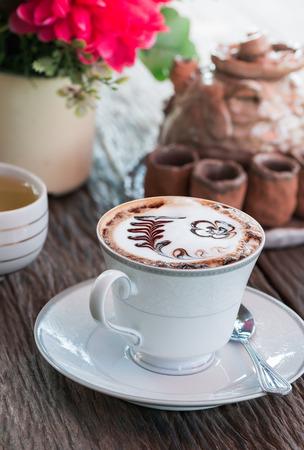 mocha: Mocha coffee on wooden background