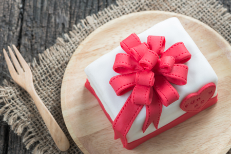 fancy sweet box: Cake Of Ribbon Box on wood background Stock Photo