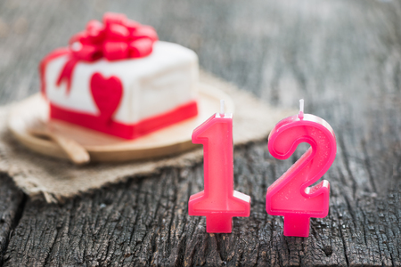 fondant fancy: number candle in front of cake. Stock Photo