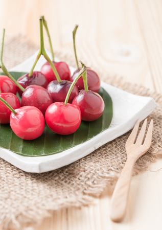 green background: deletable imitation fruits Look Choup on wood background