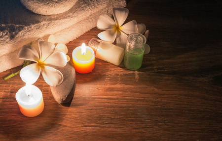 A home spa setting with soap and shampoo on candles light.