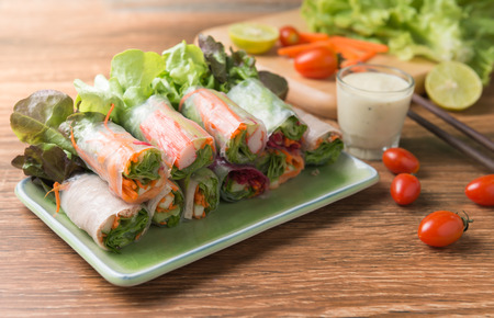 crab stick salad roll on wood background