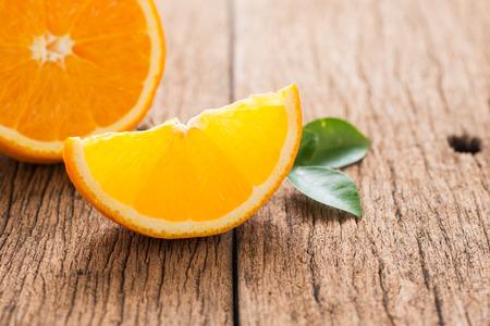 navel: slice Valencia orange or Navel orange on wood background