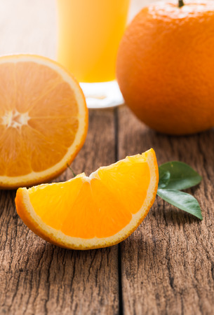 valencia orange: slice Valencia orange or Navel orange on wood background