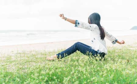 girlie: The girl, having stretched hands, relax on the beach