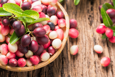 pituitary: carunda fruit on old wood background, Fruit helps relieve sore throat and pituitary.