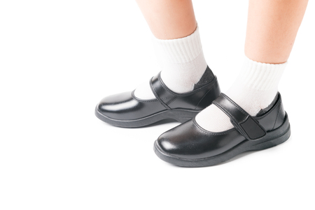 zapatos escolares: Asian Thai girls schoolgirl student wear a black leather shoes as a school uniform in isolated background