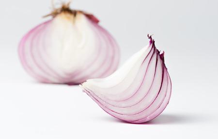 Sliced fresh shallot or onion on white background.