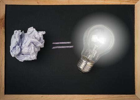 crumple: crumple paper and bulb light on black blackboard and copyspace Stock Photo