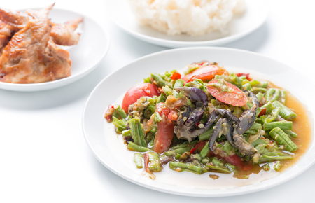 Long Bean Salad with salted crab isolated on white, Thai food. Stock Photo