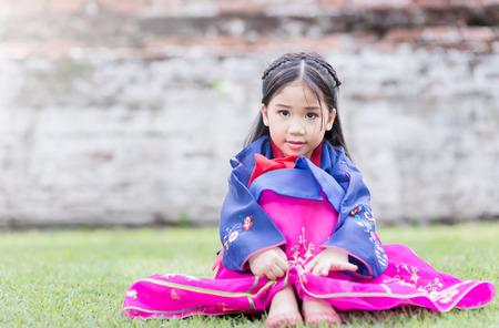 hanbok: cute girl wearing  National Costumes of Korea in park