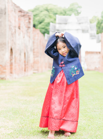 hanbok: cute asian girl wearing Korea costumes show love symbol hand.