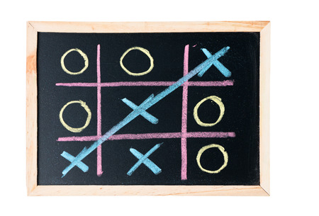 x games: tic tac toe on a black chalkboard isolated on white background