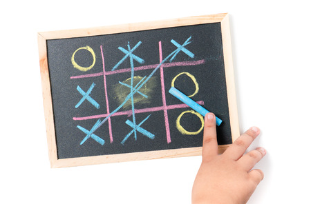 cheat: boy  hand drawing a game of tic tac toe, concept play cheat. Stock Photo