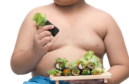 overweight kid: salad roll on fat boy hand isolated on white background, concept diet and healthy food.