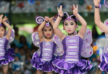 LOP BURI, THAILAND - OCTOBER 7, 2016 : Unidentified cute Children cheerleaders in annual sports day on October 7, 2016 at Lop Buri  Province,Thailand.