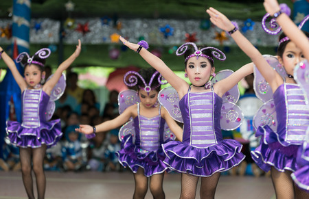 pom: LOP BURI, THAILAND - OCTOBER 7, 2016 : Unidentified cute Children cheerleaders in annual sports day on October 7, 2016 at Lop Buri  Province,Thailand.